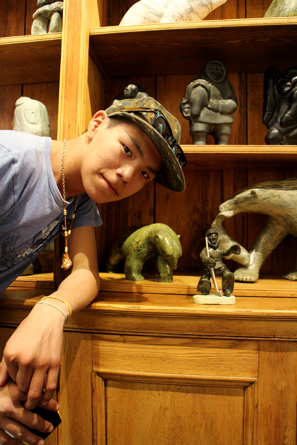 Parr with a carving made by his father, at the Feheley Fine Art Gallery. Photo by Alexa Hatanaka.