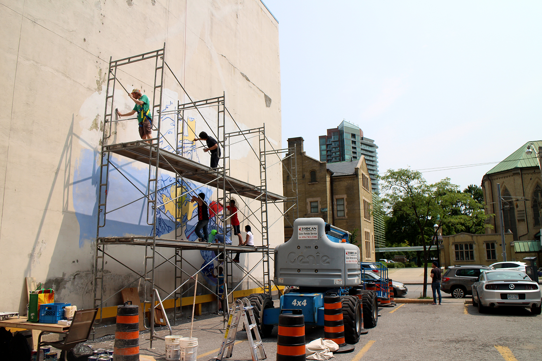 Painting two stories above the ground. Photo by Alexa Hatanaka.