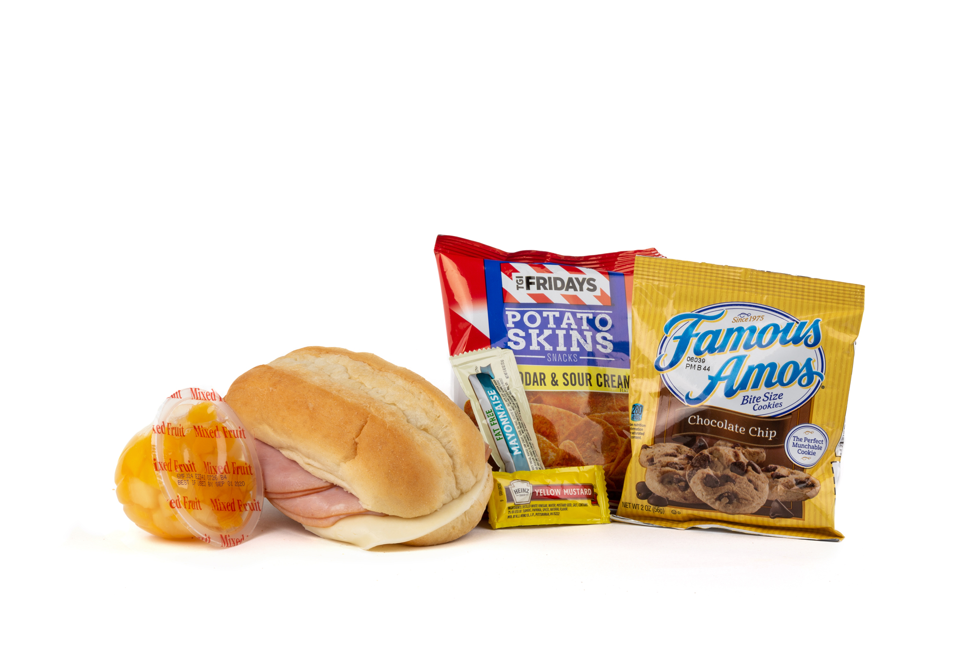 FK01ND - Ham/Provolone Sandwich - Frozen NO DRINK NAPA 894001E619559  Sandwich - Ham/Provolone on Sub Bun Frozen Chip Potato TGIF Cheddar Bacon Mixed Fruit Cup Cookie Choc Chip Famous Amos Mayonnaise Packet Fatfree Dressing Mustard Packet Candy Mint Starlight Spearmint
