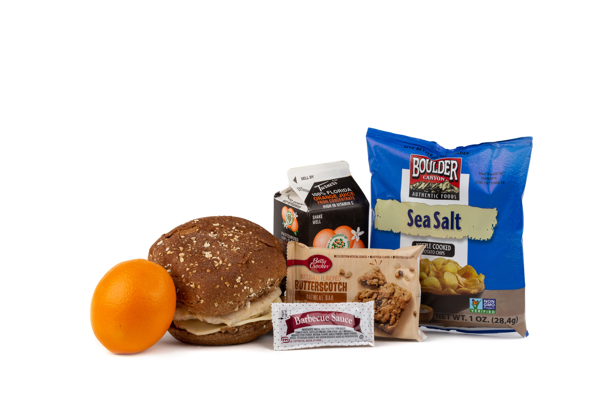 MK02 - Fresh Chicken Barbeque  Grilled Chicken Breast/ Pepper Jack Cheese on Wheat Bun BBQ Sauce Packet Orange Juice Chip Potato Bag Boulder Canyon w/ Sea Salt Juice Orange Butterscotch Oatmeal Bar