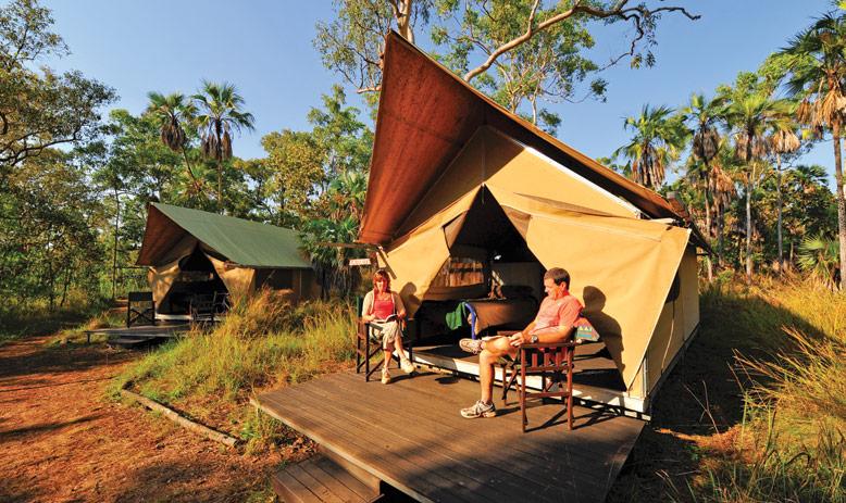 Australia_WA_Kimberley_Mitchell Plateau_Couple sitting outside of tent on deck_APT_Lodge07_LLR.jpg