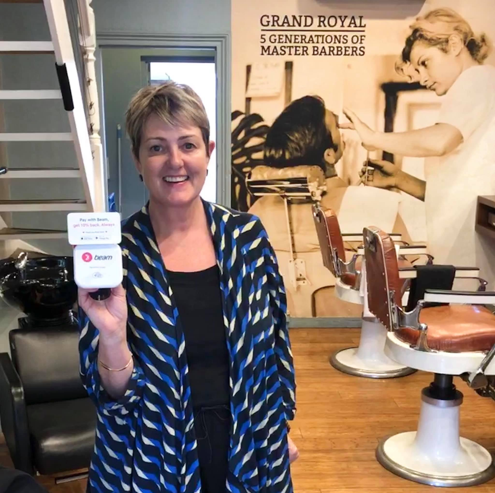 Maria Dillon excited to accept Beam at her Darlinghurst barber shop.