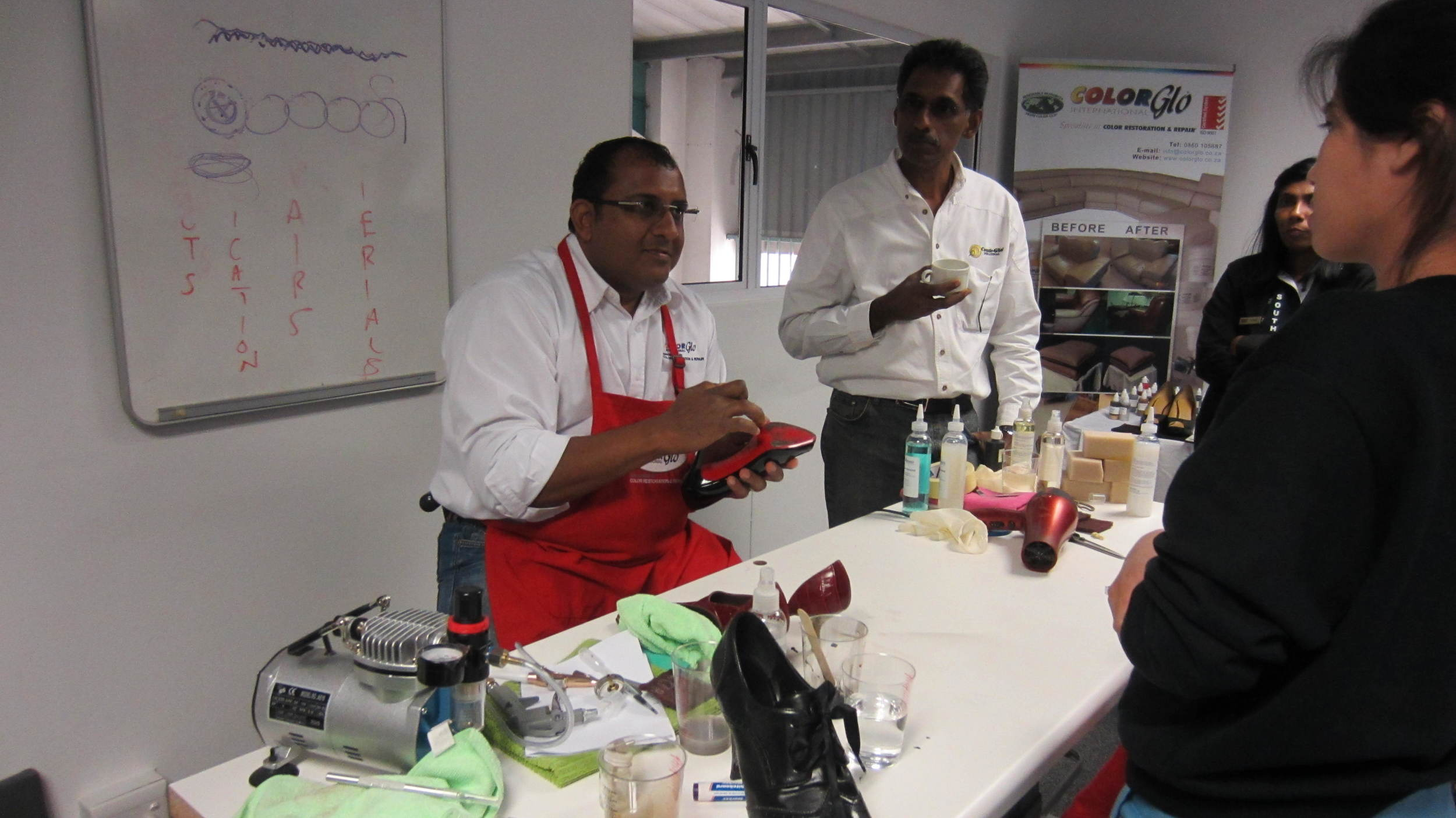 Ruben doing a shoe repair demonstration
