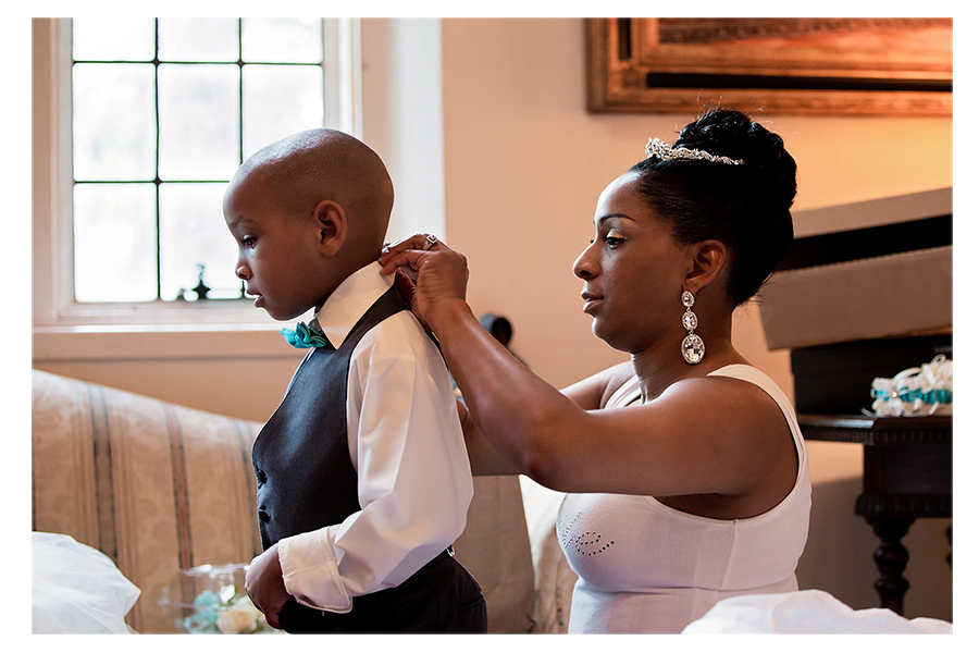 The bride helping her son get ready for the wedding. Precious!