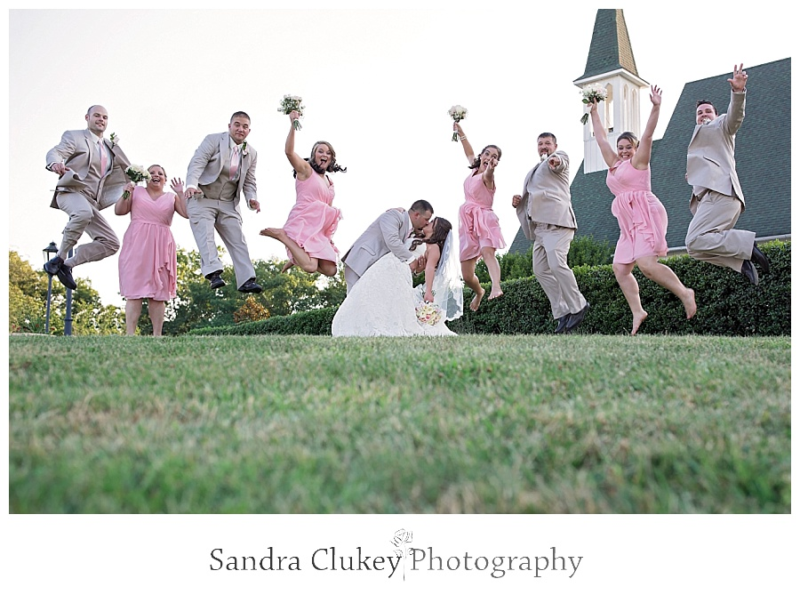 Jumping High with Bride and Groom