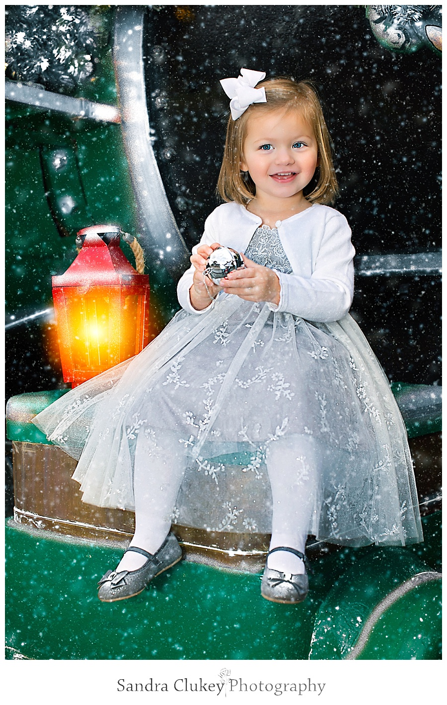 Christmas child with bell on train