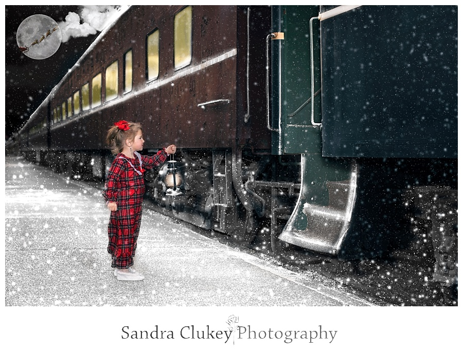Child with lantern looks into train