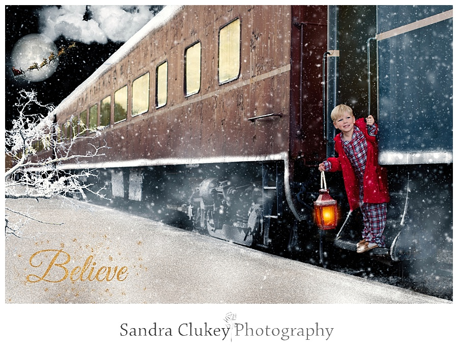 Boy on train with Santa and moon