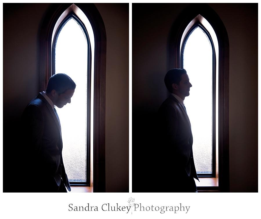Pensive Groom by church windows