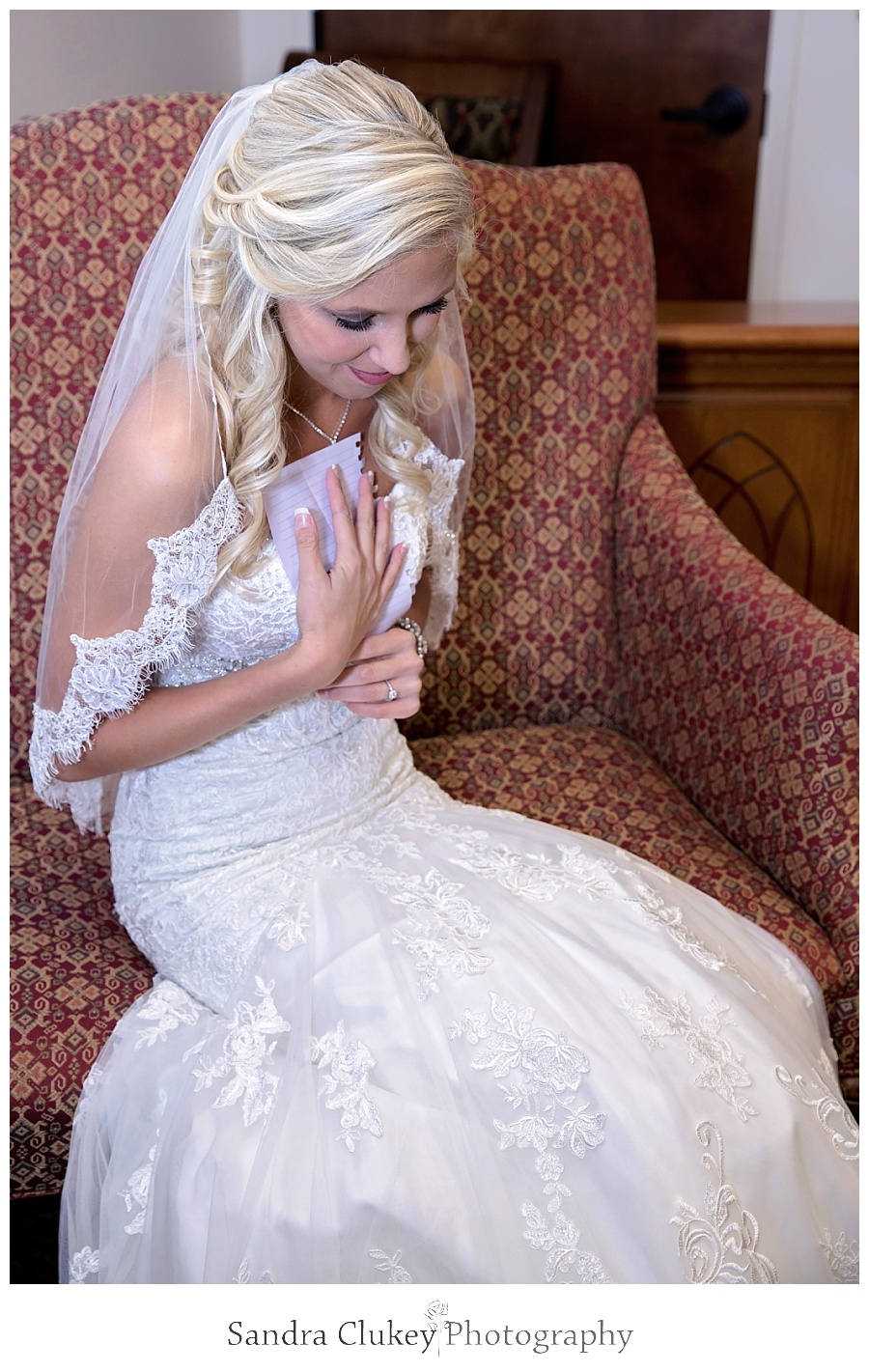 Brides reaction after reading letter from groom