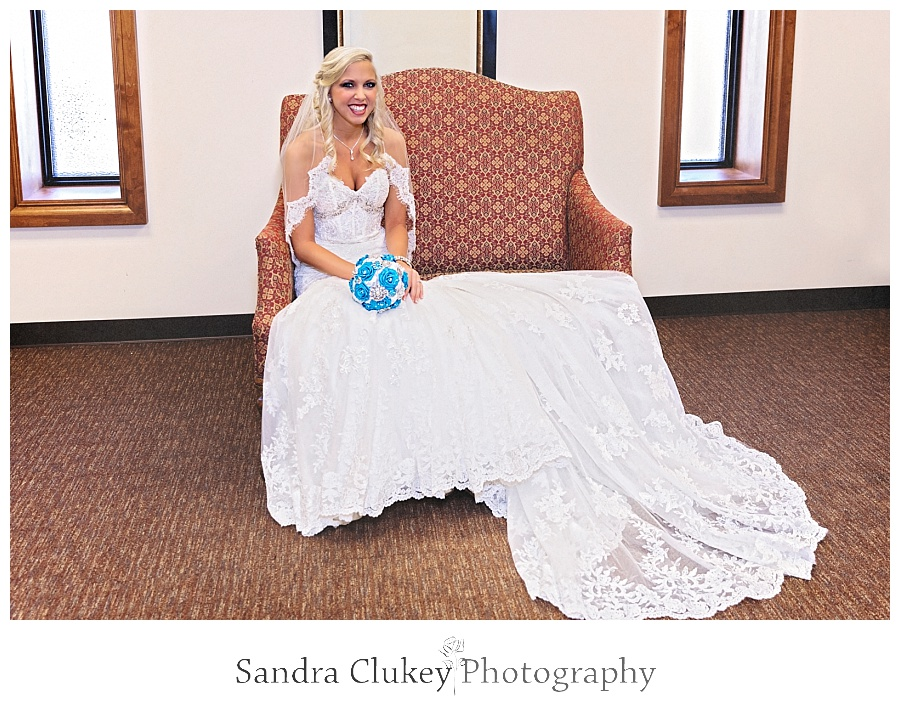Bride on chair at Lee University Chapel room