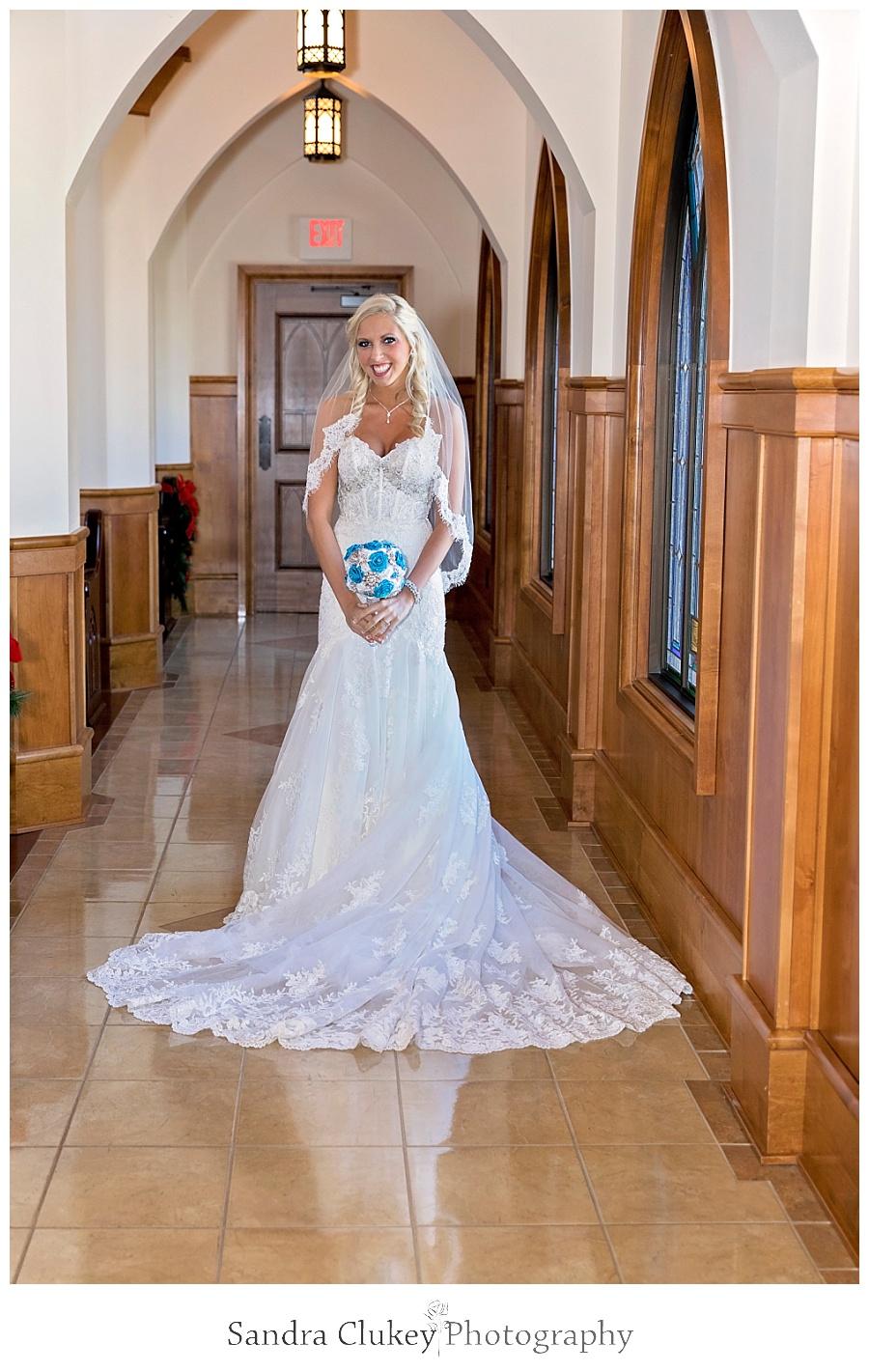 Dazzling bride in church aisle