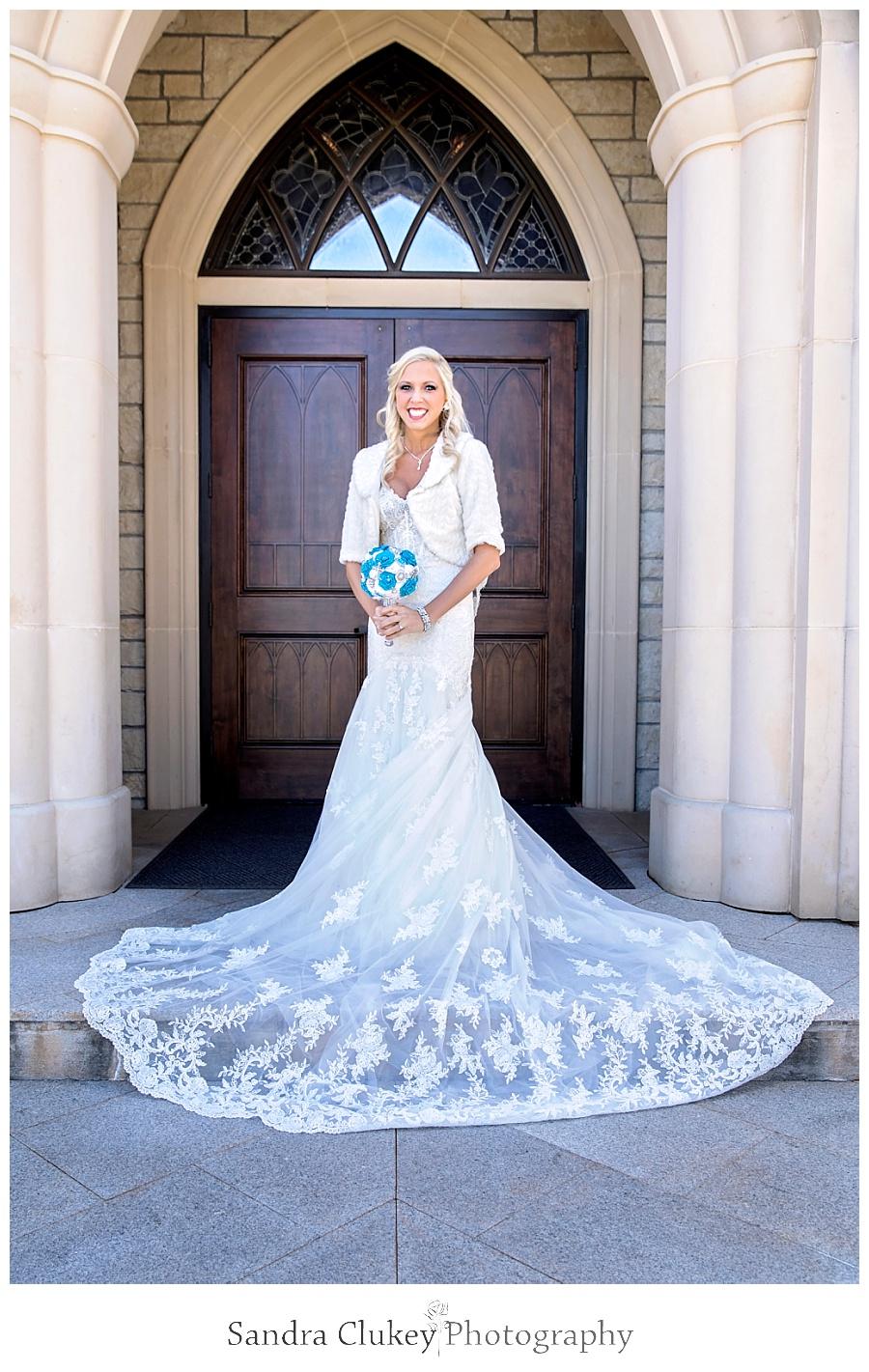 Bride at doors outside of Lee University Chapel