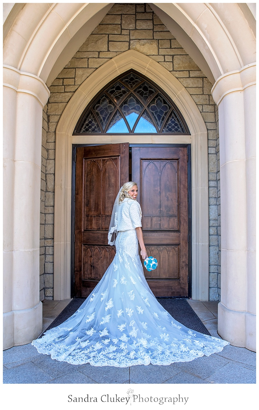 Bride's cathedral length train at chapel doors