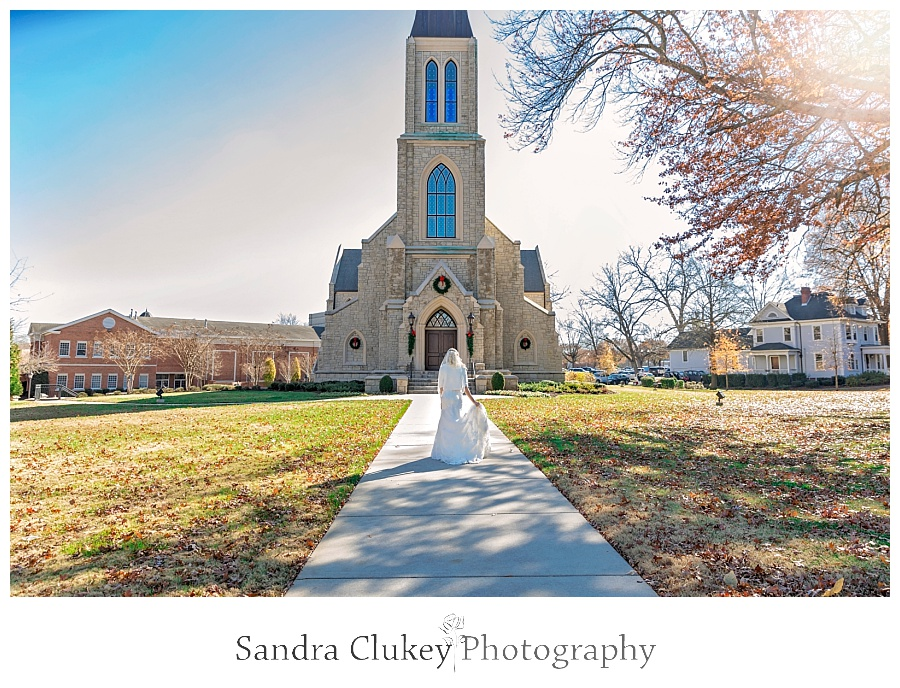 Bride walks toward Lee University Chapel