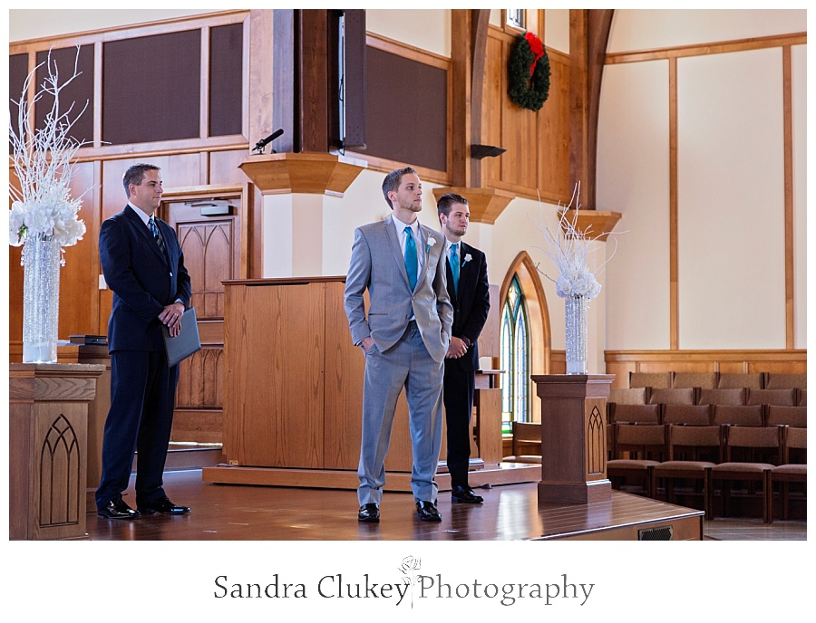Groom at Alter