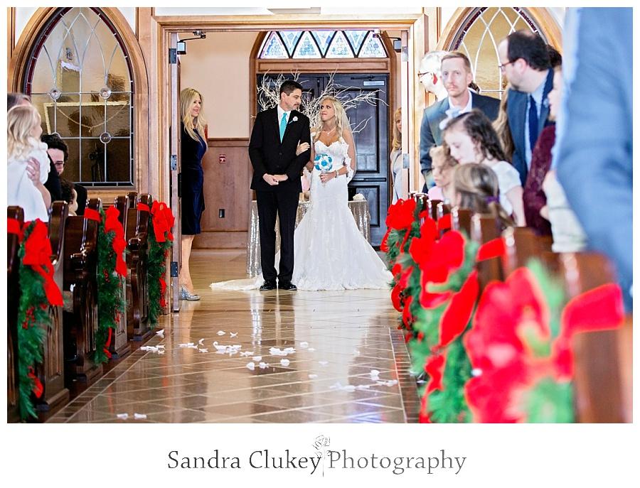 Bride walks down center isle