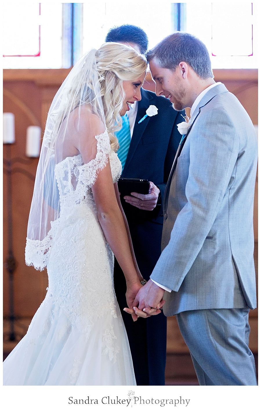 Bride and Groom pray in the chapel at Lee University