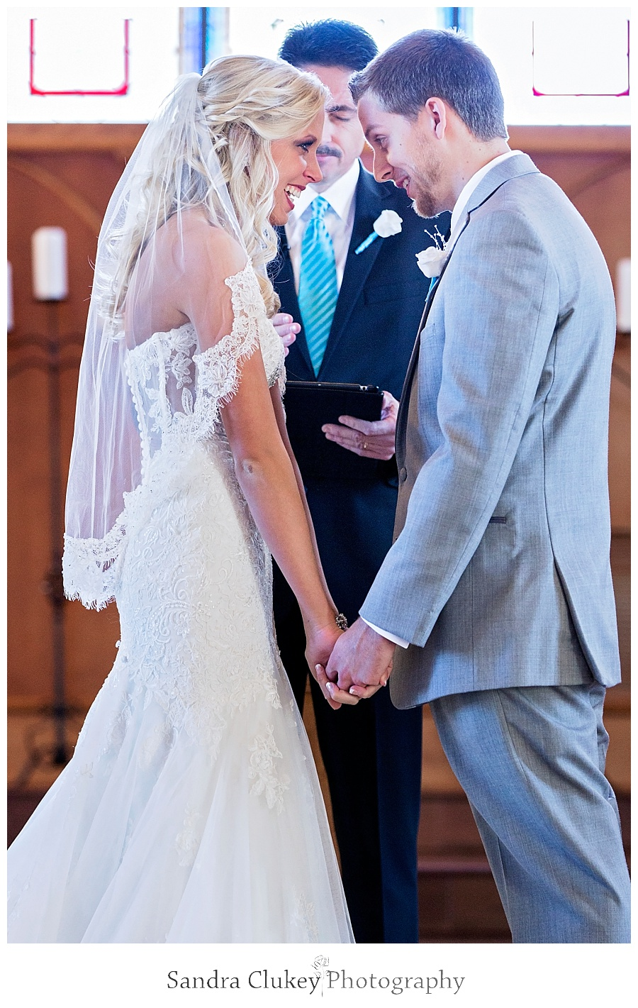 Bride and Groom pray during ceremony