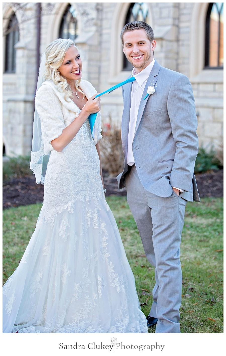 Bride grabs grooms tie