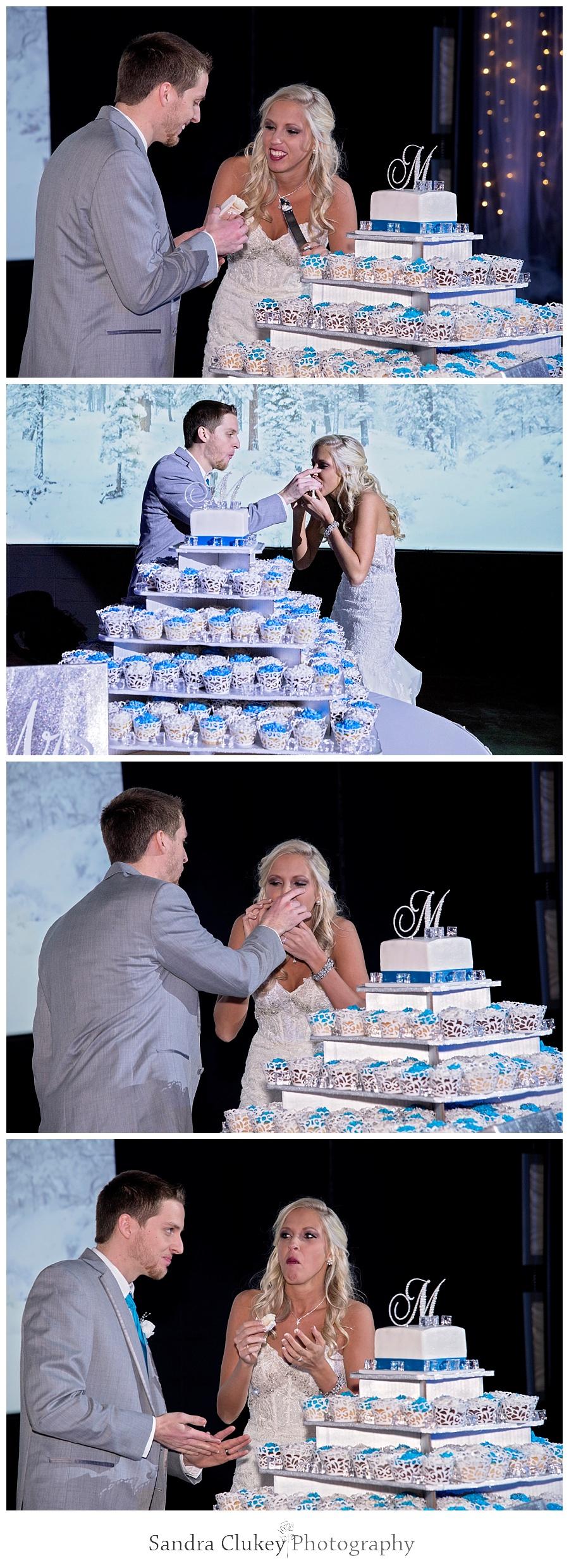Groom feeds Bride wedding cake