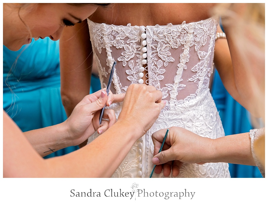 Final steps with bride and dress
