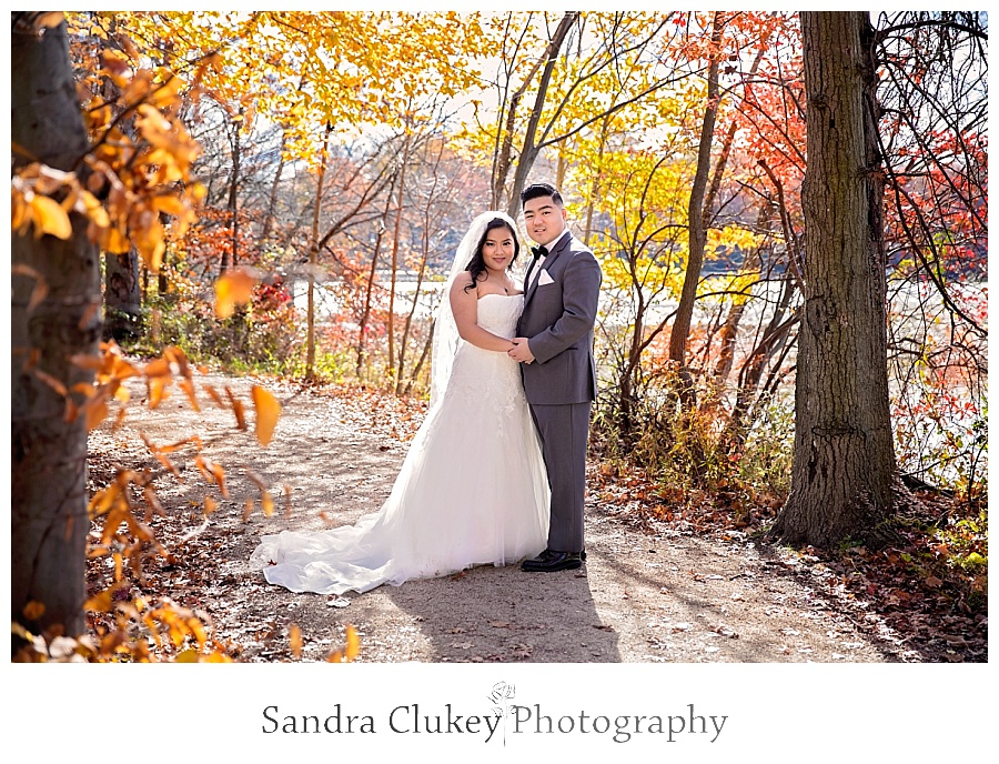 Stunning couple on tree lined path during first look
