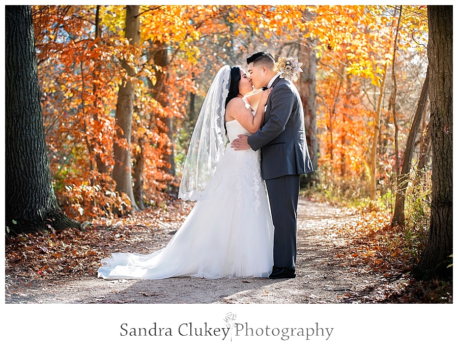 Glamorous couple on fall colored path