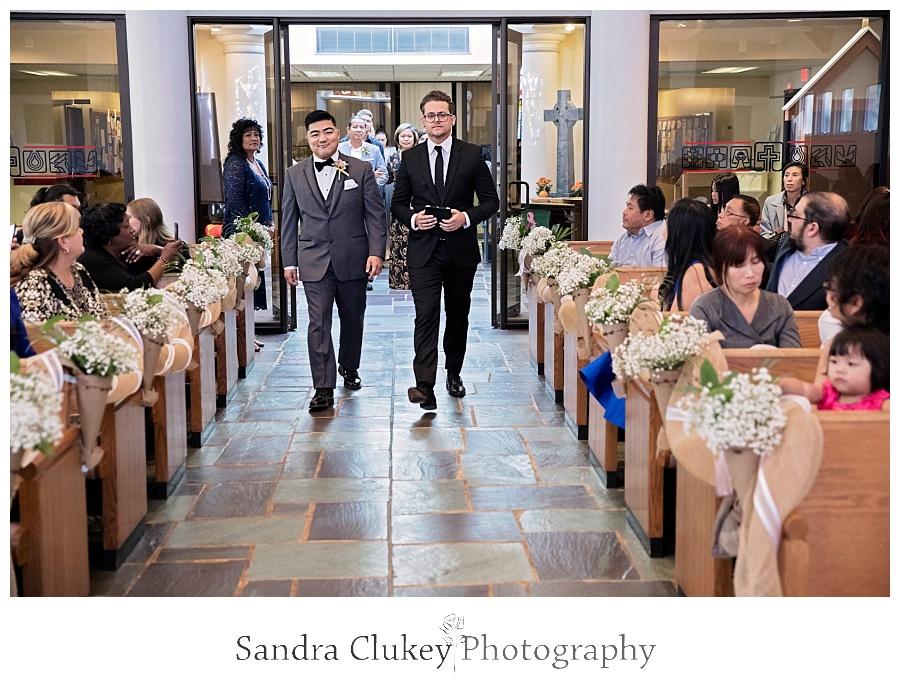 Joyful groom and minister enters