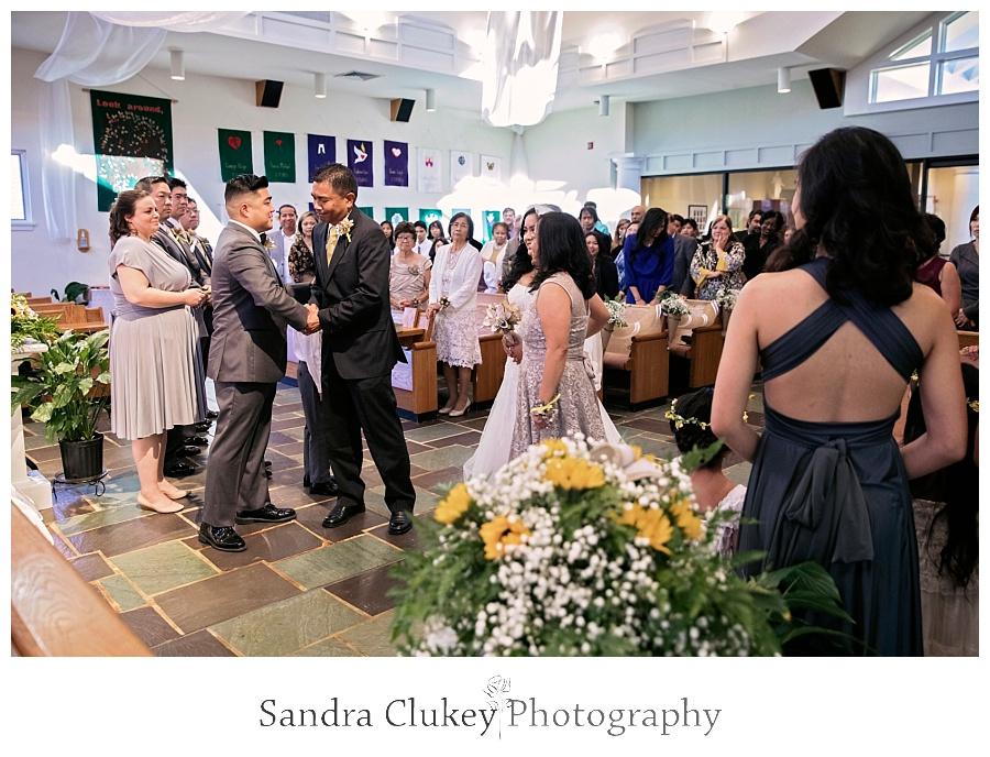 Dad congratulates the groom