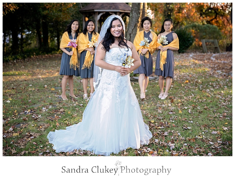 Advancing bride with her bridemaids