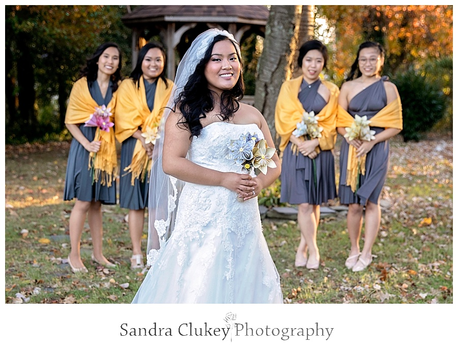 Isolated bride with girls looking on