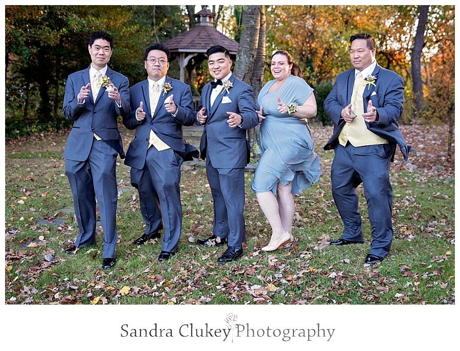 Gleeful groom with his group