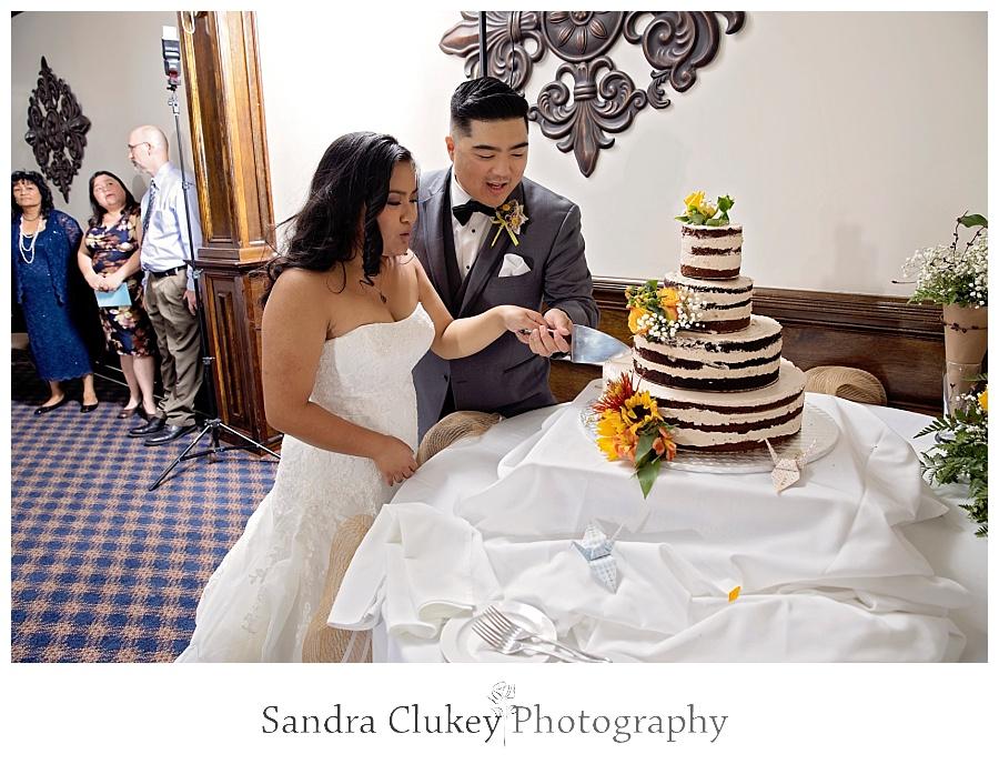 Team work cutting the cake