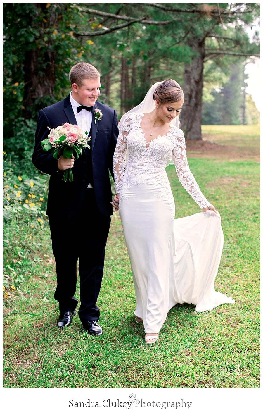 Bride and groom walking in Fletcher Park, Cleveland TN.  Copyright Sandra Clukey Photography, LLC  https://www.sandraclukeyphotography.com/