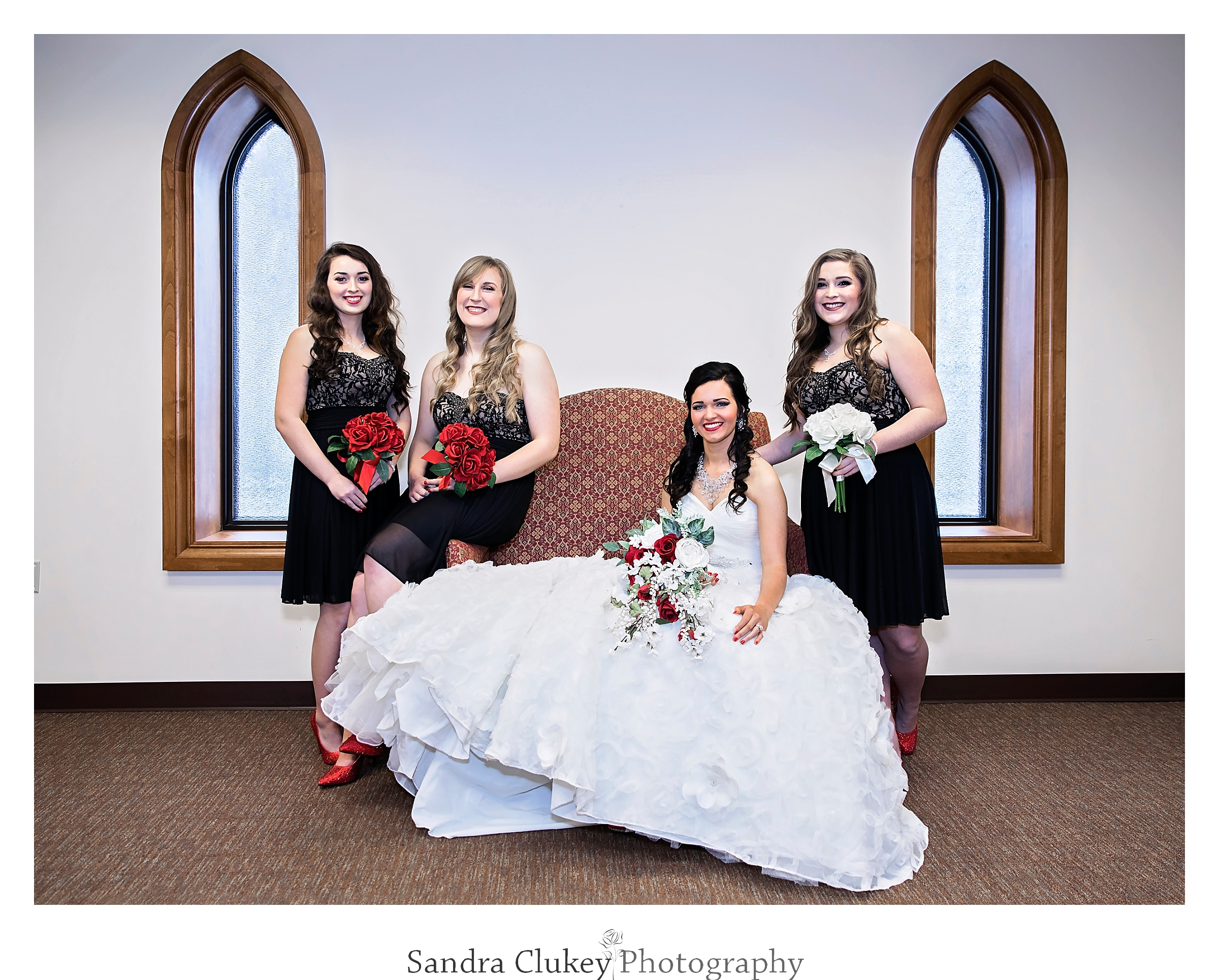 timeless image of bride with her girls at Lee University Chapel, Cleveland TN