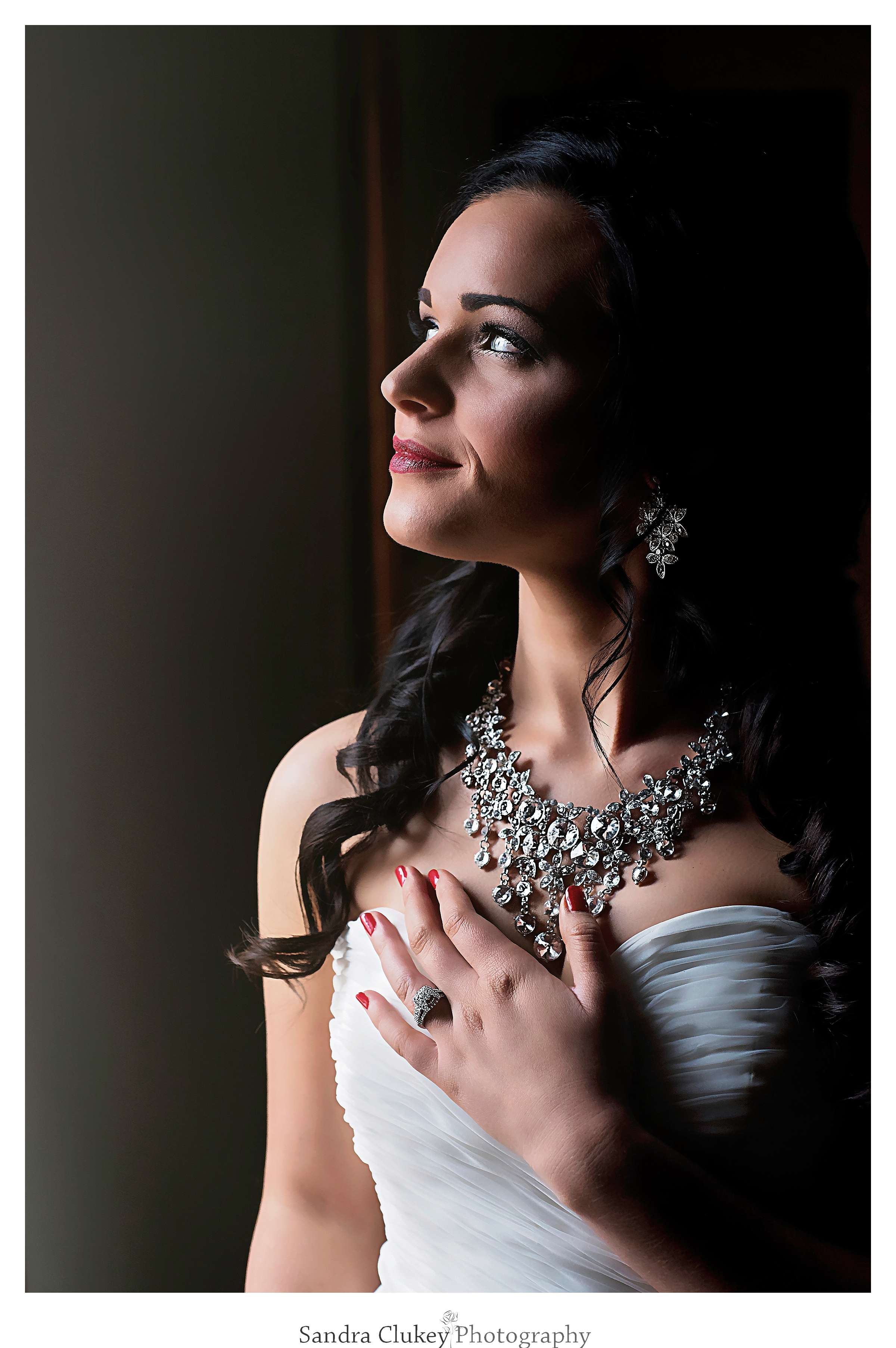 Stunning bride in deep reflection at Lee University Chapel, Cleveland TN