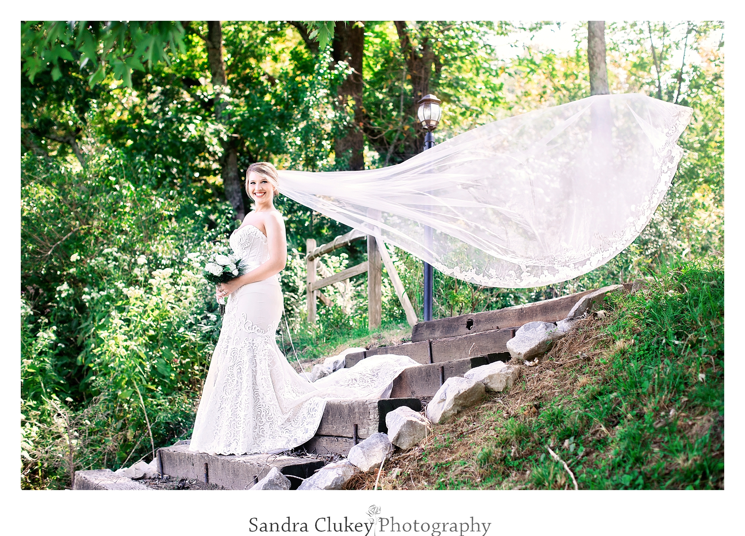 Bride descends a stairway at Tennessee RiverPlace