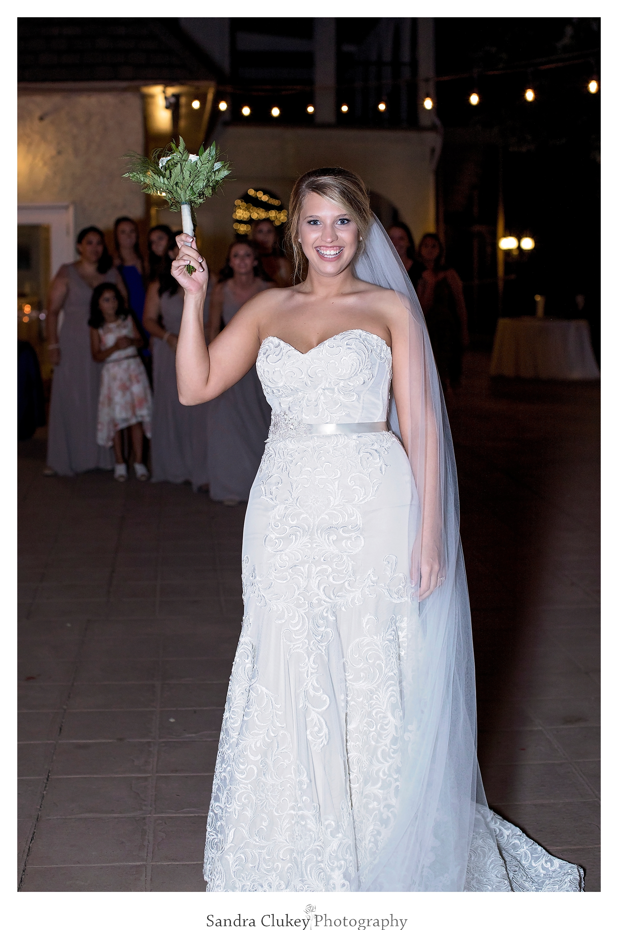 Bride preparing to toss bouquet at