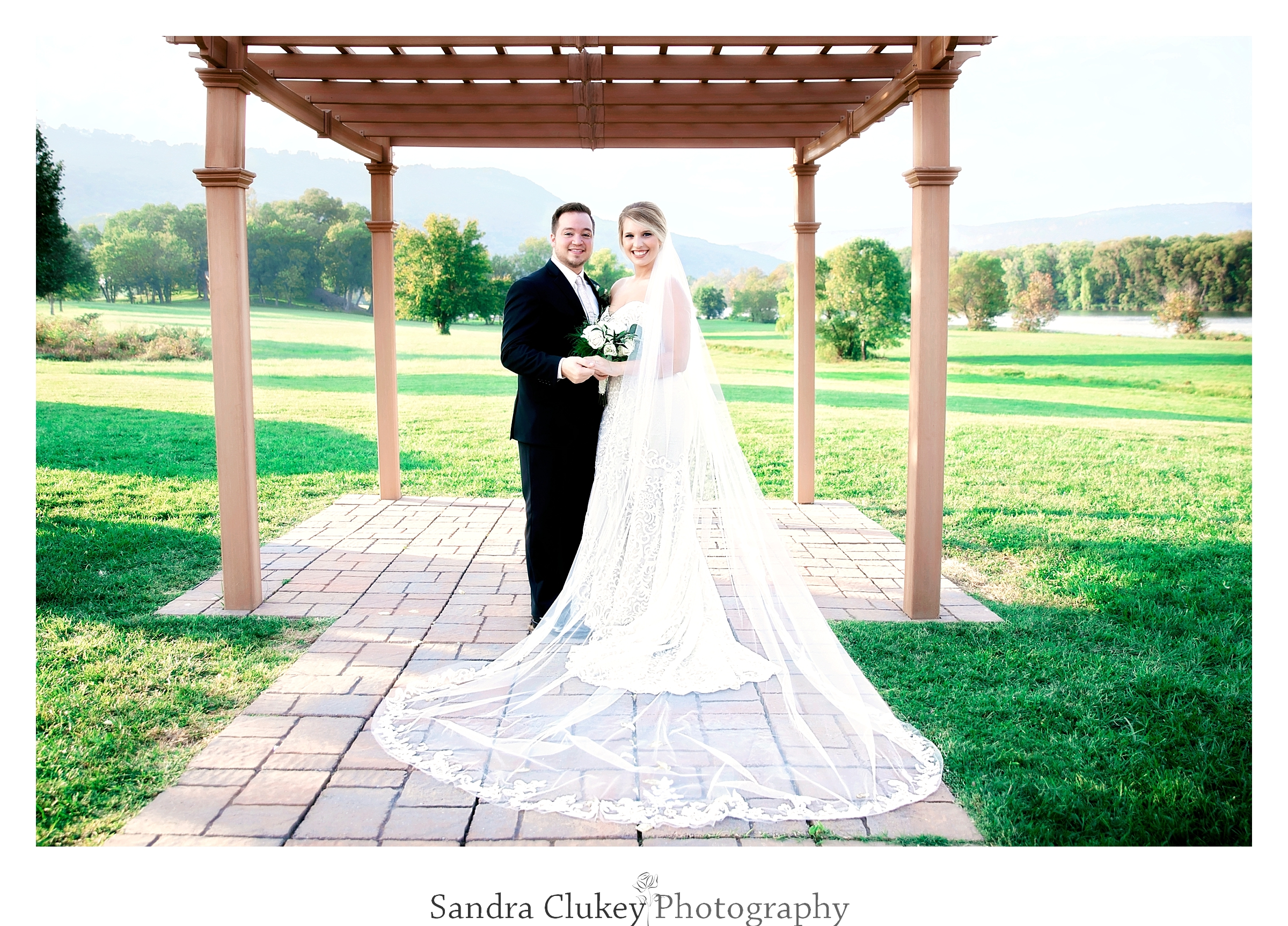 Exuberant Bride and Groom formal Portrait. Tennessee RiverPlace, Chattanooga TN