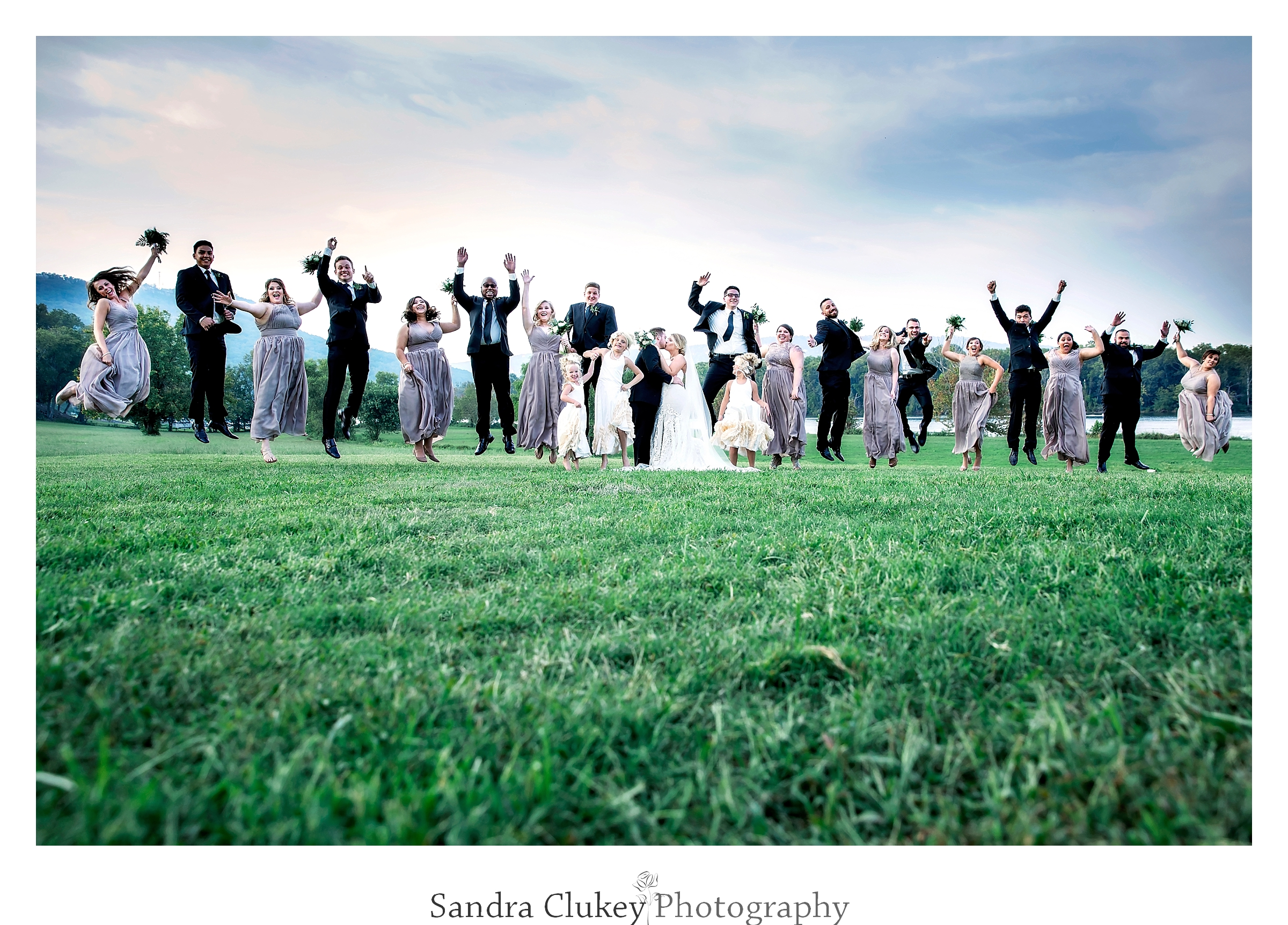 Wedding party jump at Tennessee RiverPlace, Chattanooga TN