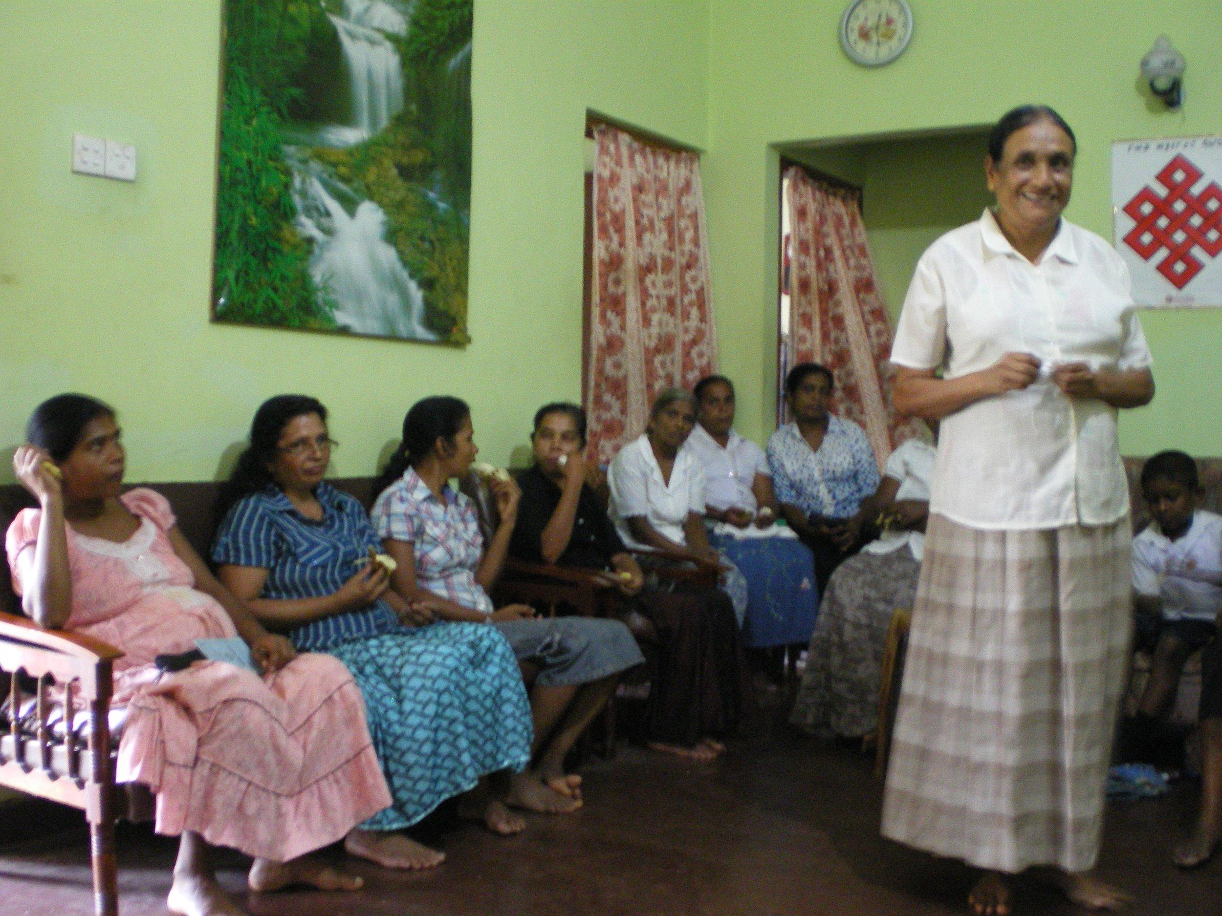 Women gathered for their self-help group meeting in Parakatawella, Sri Lanka.