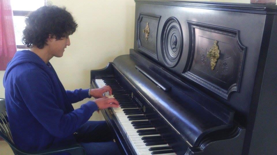 Fernando in his practical studies in Music.