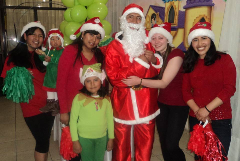 The girls of Helping Hands office together with our Santa Claus.