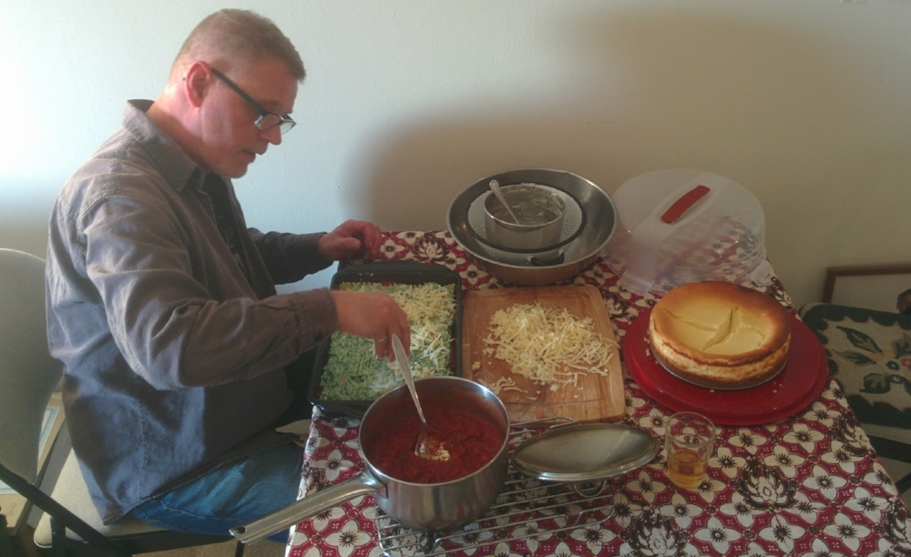 My dad busy making my sister's lasagna and cherry cheesecake for her birthday last year.