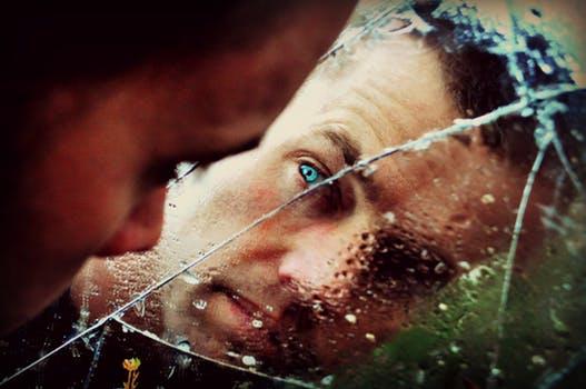 man in swing reflecting