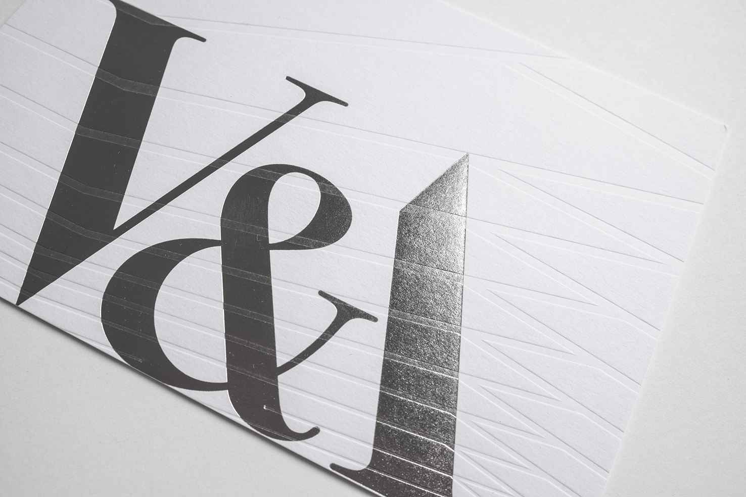 Victoria and Albert Museum  Opening invitation, 2017  The V&A commissioned Margot Lombaert Studio to design invitations for two events relating to the opening of their major capital build project, the Exhibition Road Quarter.  The two invitations are a graphic celebration of their new building. One invitation represents the porcelain-tiled courtyard while the second one takes its lines from the geometric ceiling of the Sainsbury Gallery.