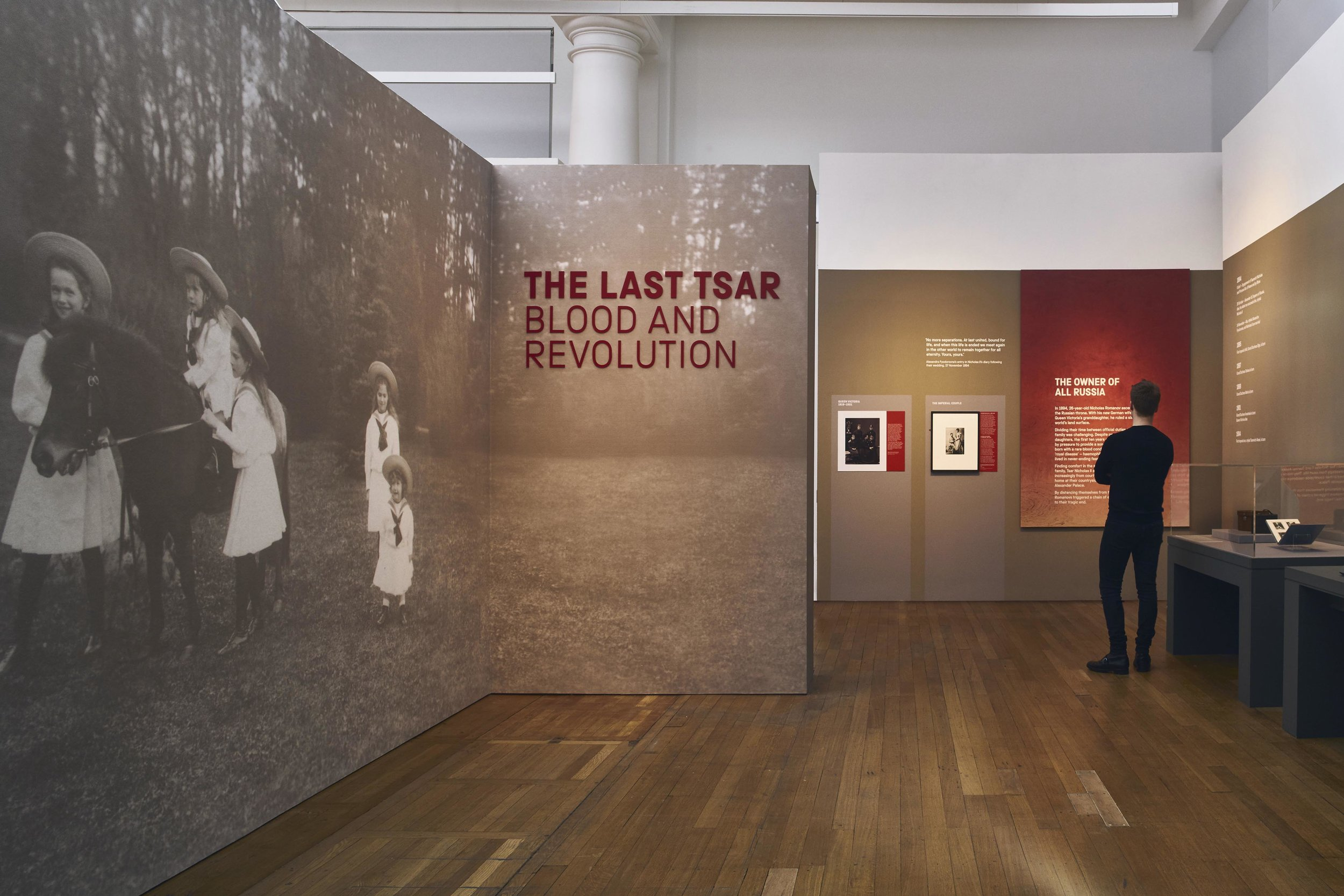 The Last Tsar: Blood and Revolution   Exhibition design, Science Museum London, 2018   Set against a turbulent backdrop of social upheaval and war between 1900 and 1918, this exhibition explores the influence of medicine on the imperial family during this period.  Using red and large scale imagery, the graphics create context and background for the collection of objects. The blood red gradient exposes the material of the panel, echoing the revelation of one of the greatest investigation of the century.