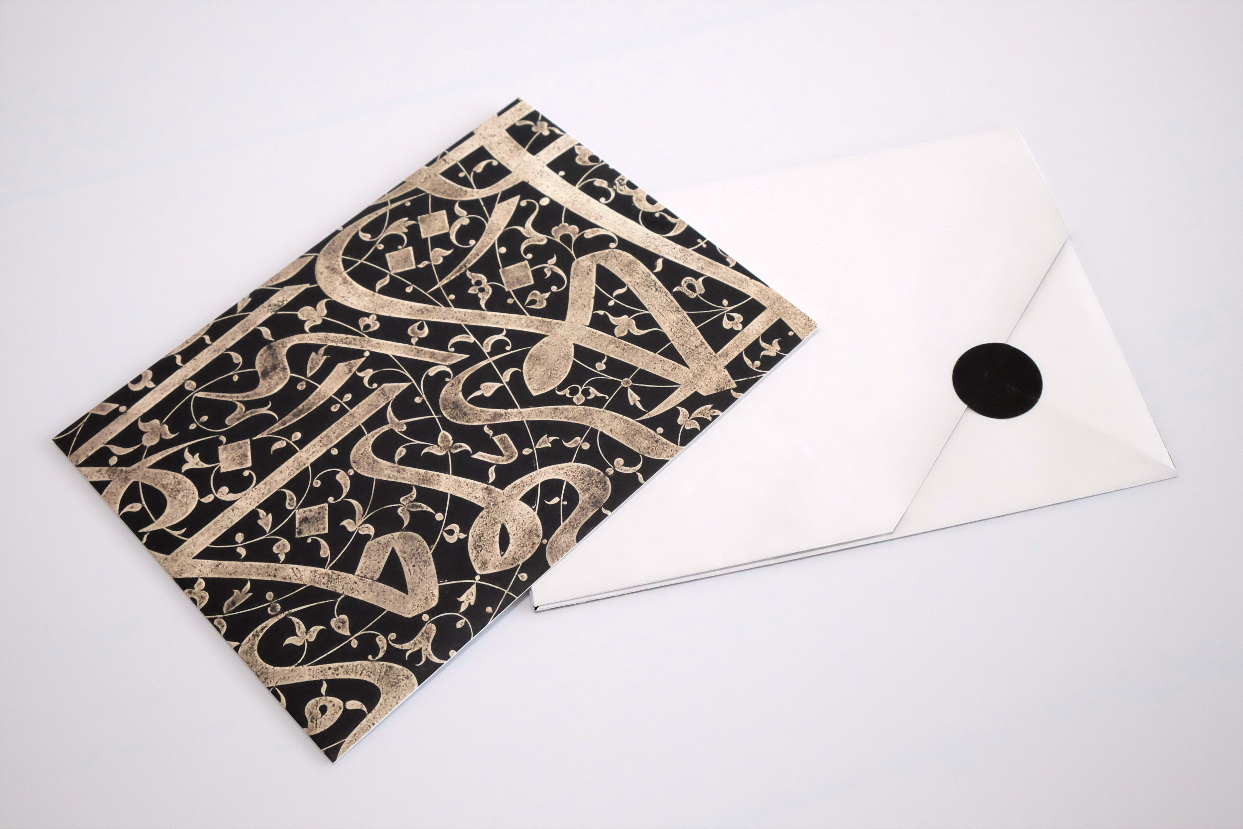 Islamic Gallery invitations   Print design, British Museum, 2018   The Islamic Gallery at the British Museum explores the wonders of the Islamic World. Margot Lombaert Studio designed invitations for the two private viewings. The design aims to surprise and create a sense of marvel while opening the invitation. The envelope unfolds into a poster showcasing a key object of the collection and allows the readers to experience its details. At the heart of the envelope, a thick, black card embellished with gold foiling gives to the guest all the event details.