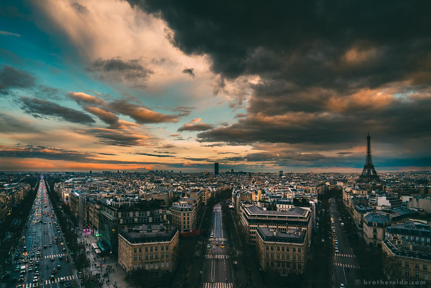 View from the top of Arc de Triomphe. The black stain in the middle is the Montparnasse Tower. [Sony a7Sii +16-35 f/4 @ 16 mm, f/4, 1/160 s, ISO 200]
